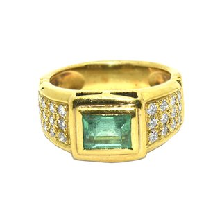 Anillo con esmeralda central y brillantes de oro 18 kilates #30730258